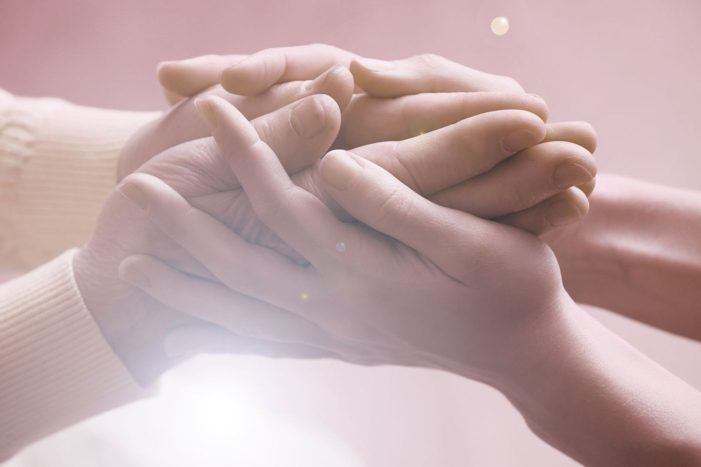 36276846 - old and young holding hands on light background, closeup